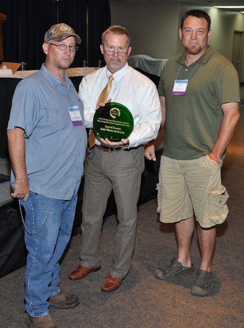 Gary Gray, Bobby Fanning, and Bryan Launius with award